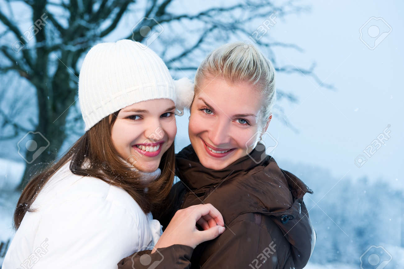 Two beautiful women in winter clothing outdoors Stock Photo - 3964334