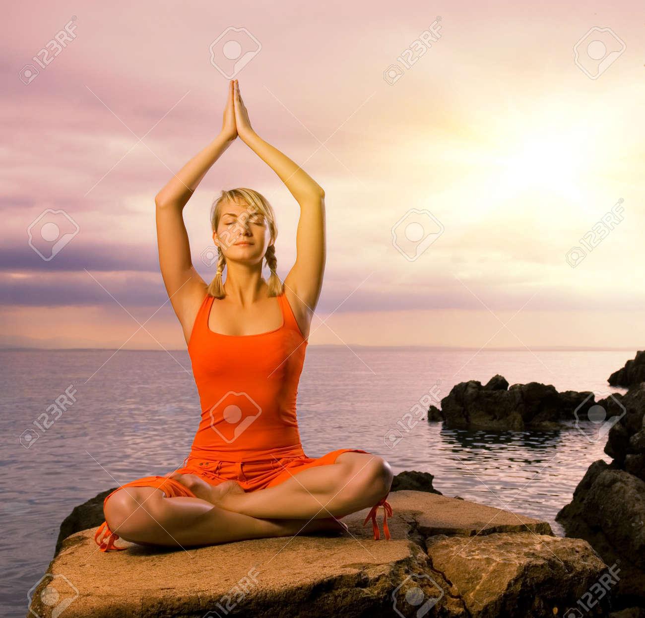 Beautiful young woman doing yoga exercise outdoors Stock Photo - 3981278