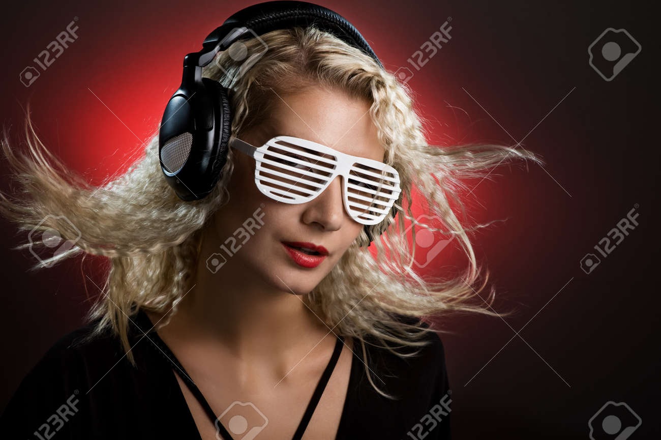 Stylish blond woman with shutter glasses and headphones Stock Photo - 4159069