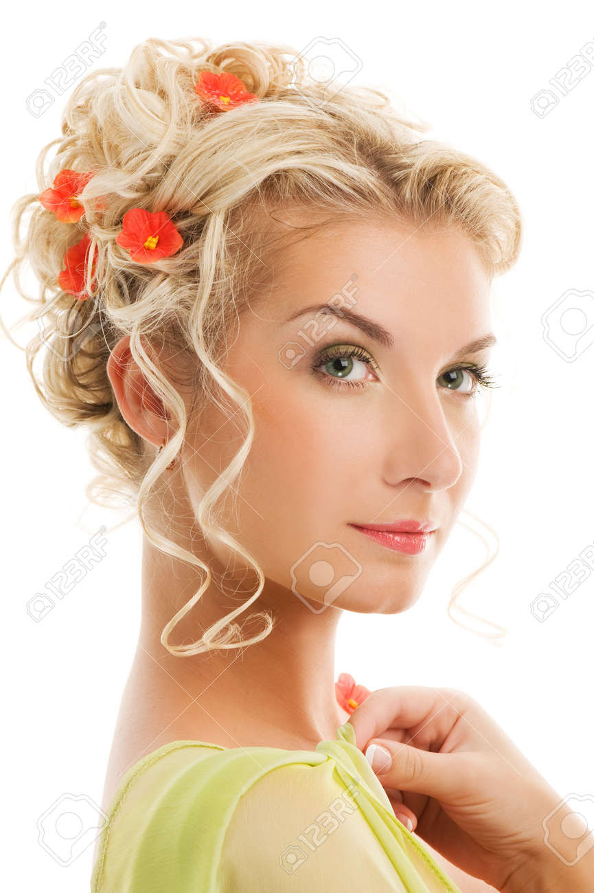 Beautiful young woman with fresh spring flowers in her hair. Spring concept. Stock Photo - 4197802