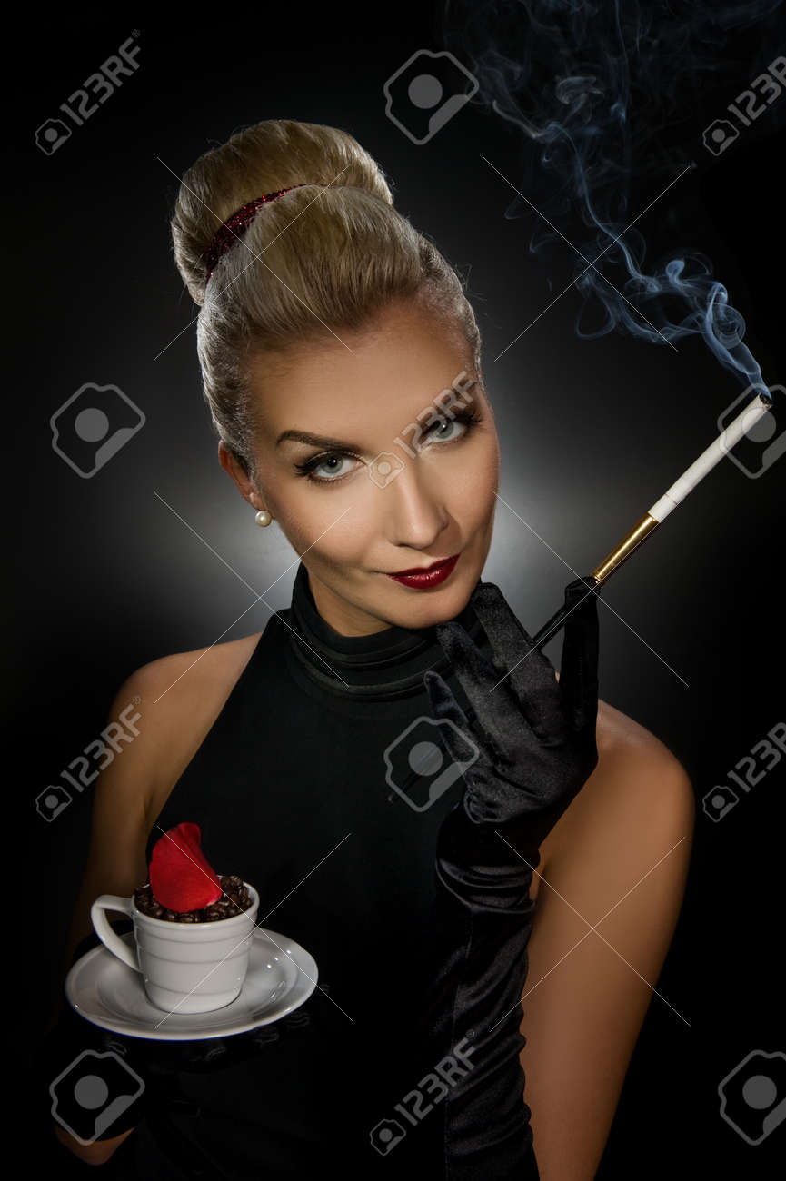 Charming lady with coffe cup and mouthpiece Stock Photo - 4218010