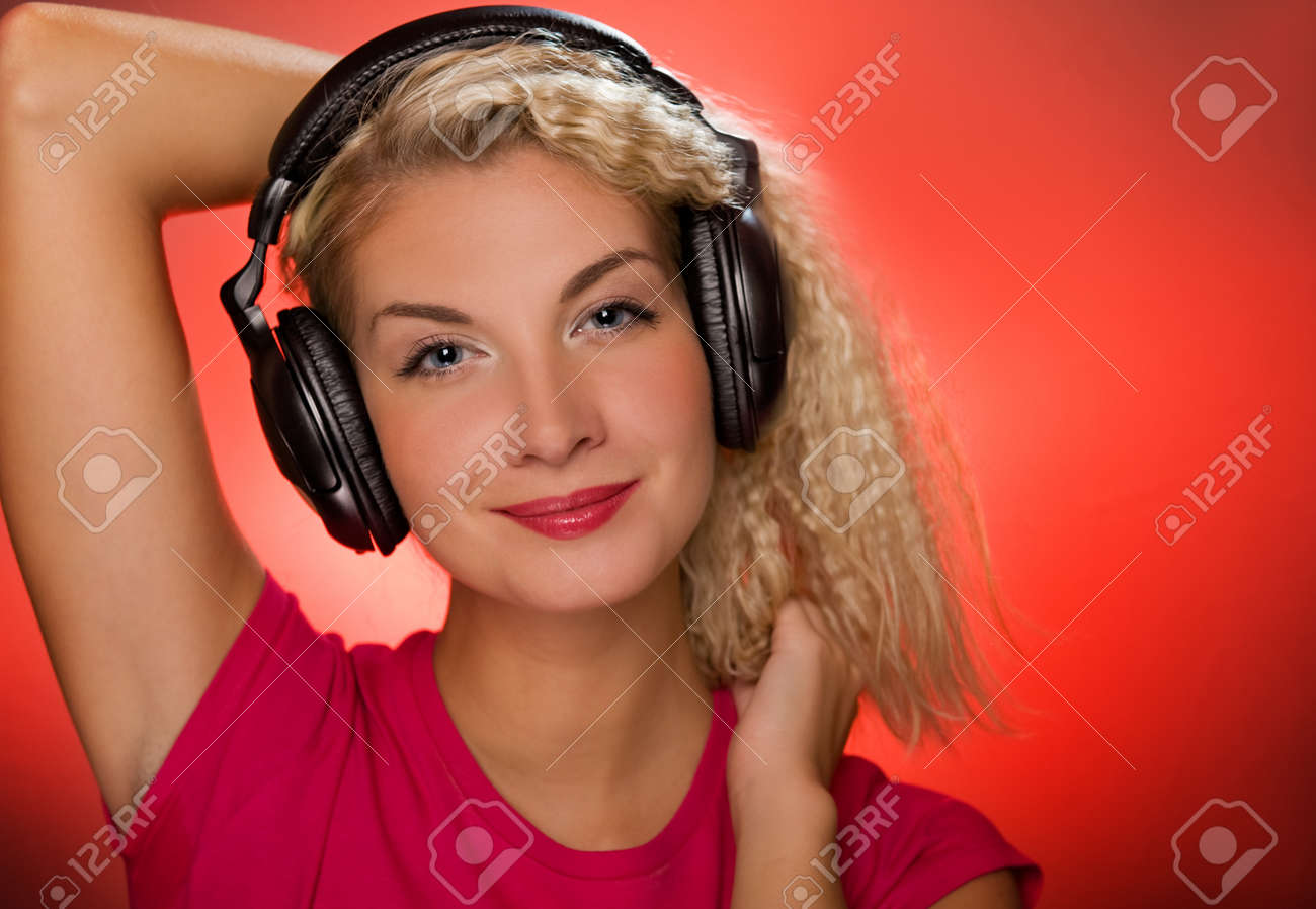 Blond woman listening to the music Stock Photo - 4299852