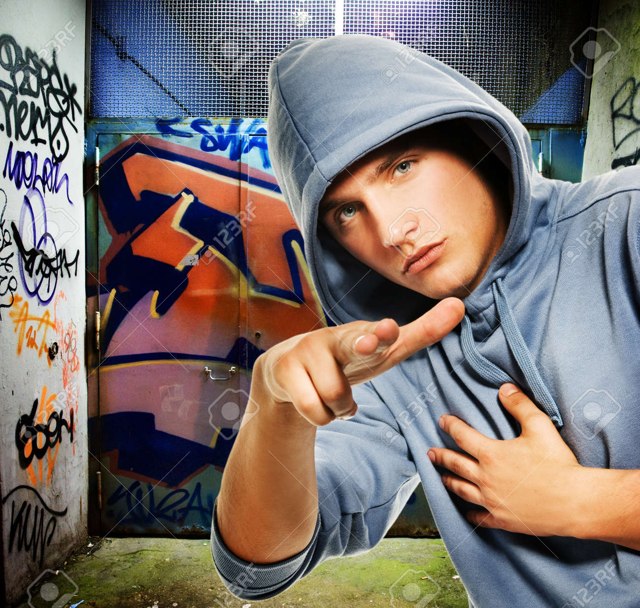 Cool looking hooligan in a graffiti painted gateway Stock Photo - 4355154
