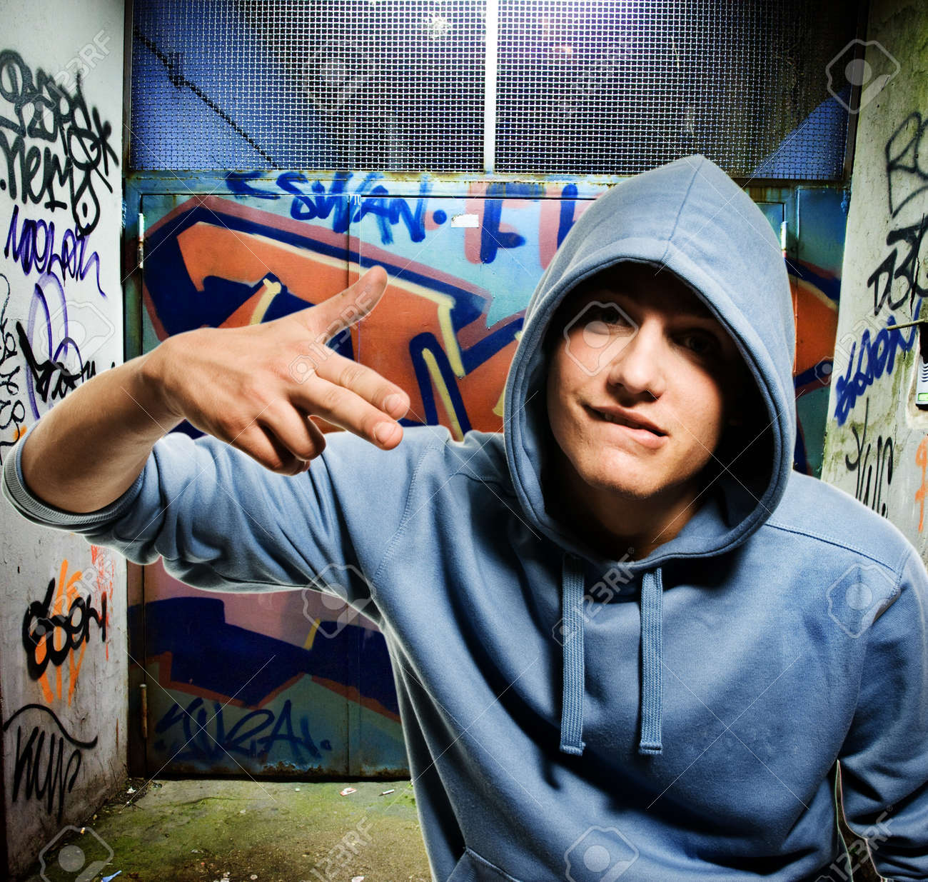 Cool looking hooligan in a graffiti painted gateway Stock Photo - 4355196