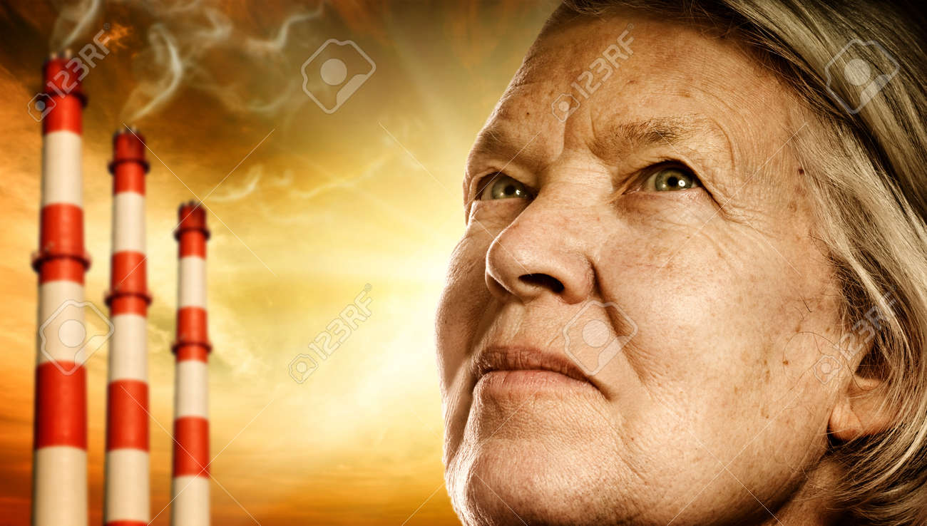 Elderly woman's face. Power plants on background Stock Photo - 4519766