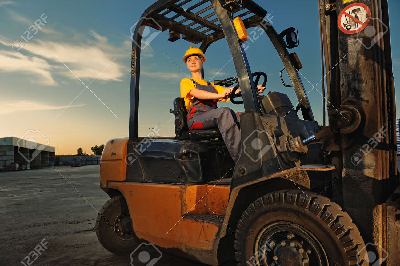 Female worker driving cargo truck Stock Photo - 4941931