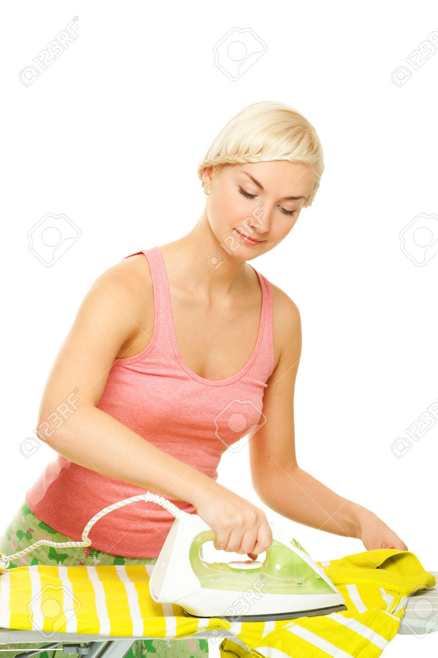Beautiful woman ironing clothes. Isolated on white background Stock Photo - 5143247