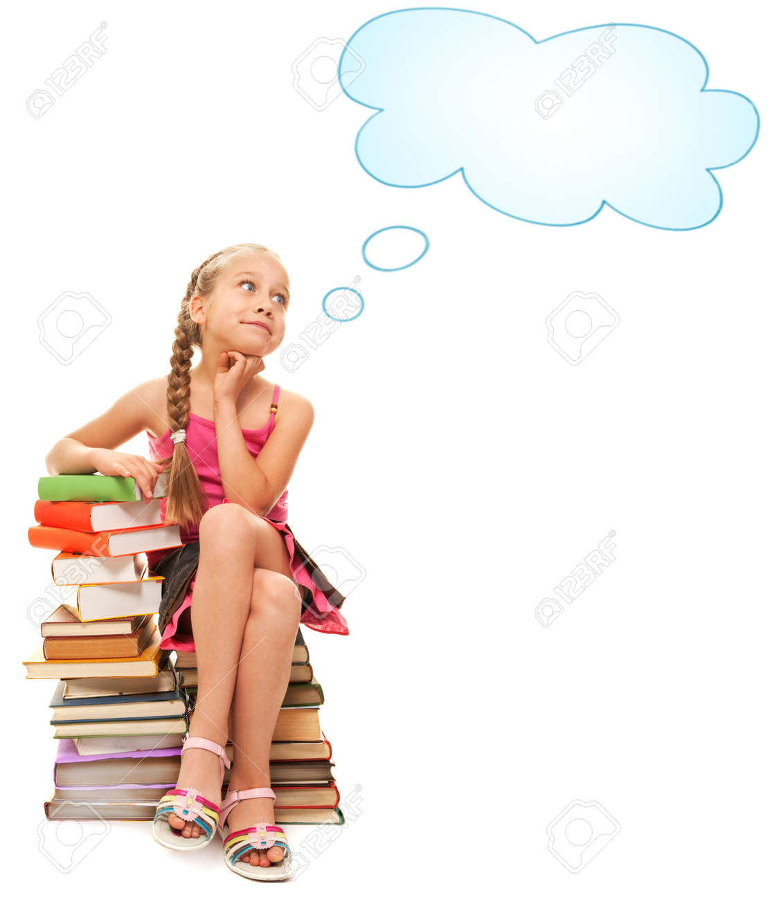 Little schoolgirl sitting on a stack of books Stock Photo - 5219415