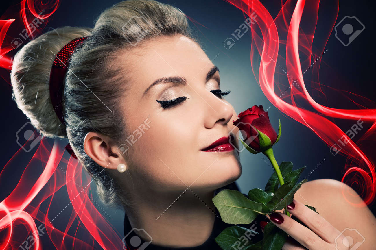 Charming lady with red rose Stock Photo - 5281799