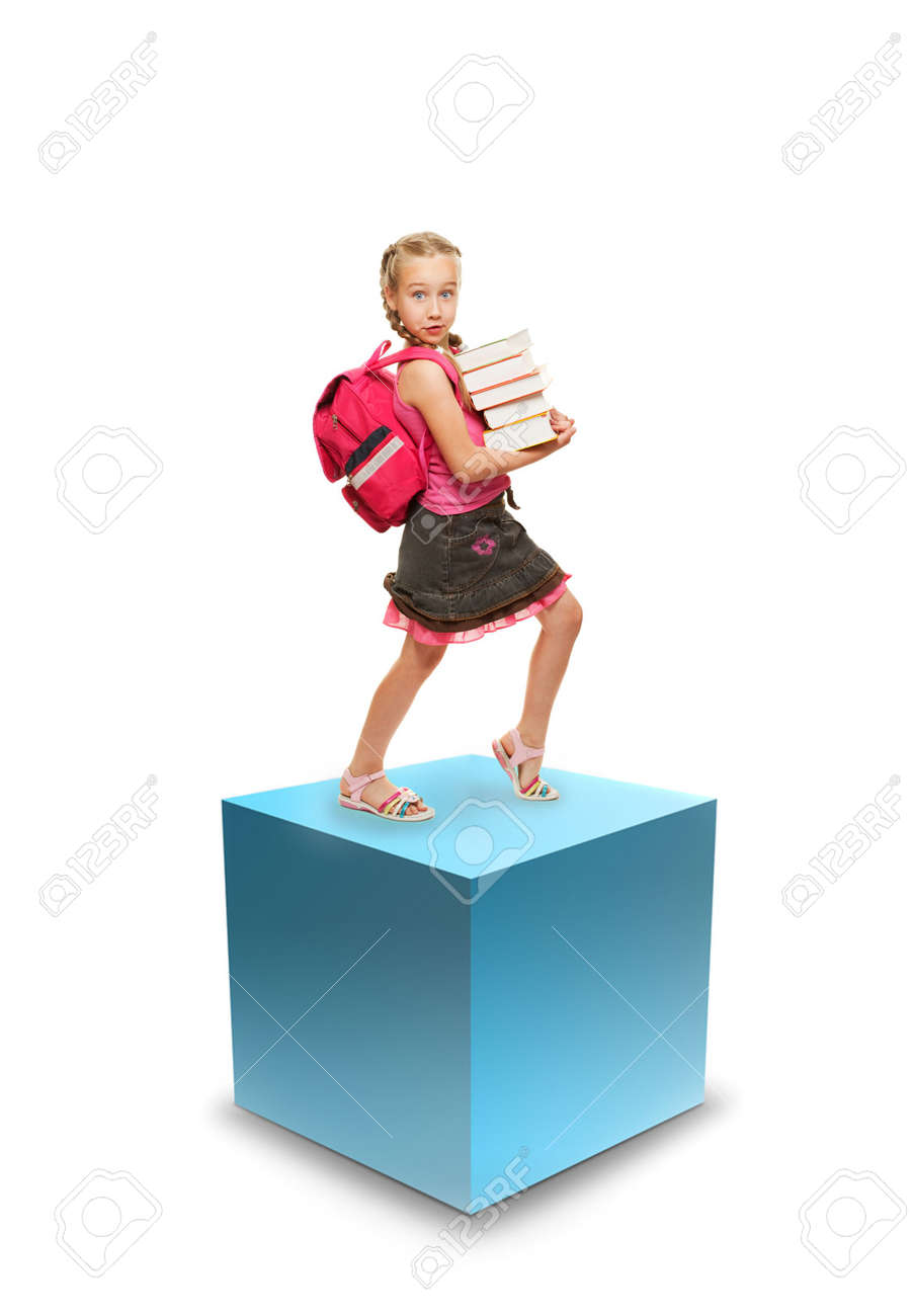Happy little schoolgirl with a stack of heavy books Stock Photo - 5310306