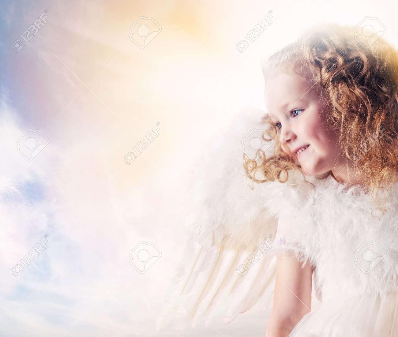 Little angel girl against sunny sky Stock Photo - 6786841