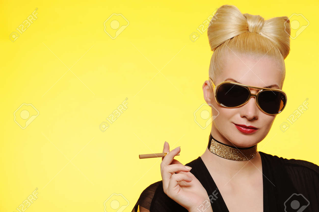 Beautiful charming lady with a cigarette Stock Photo - 6976460