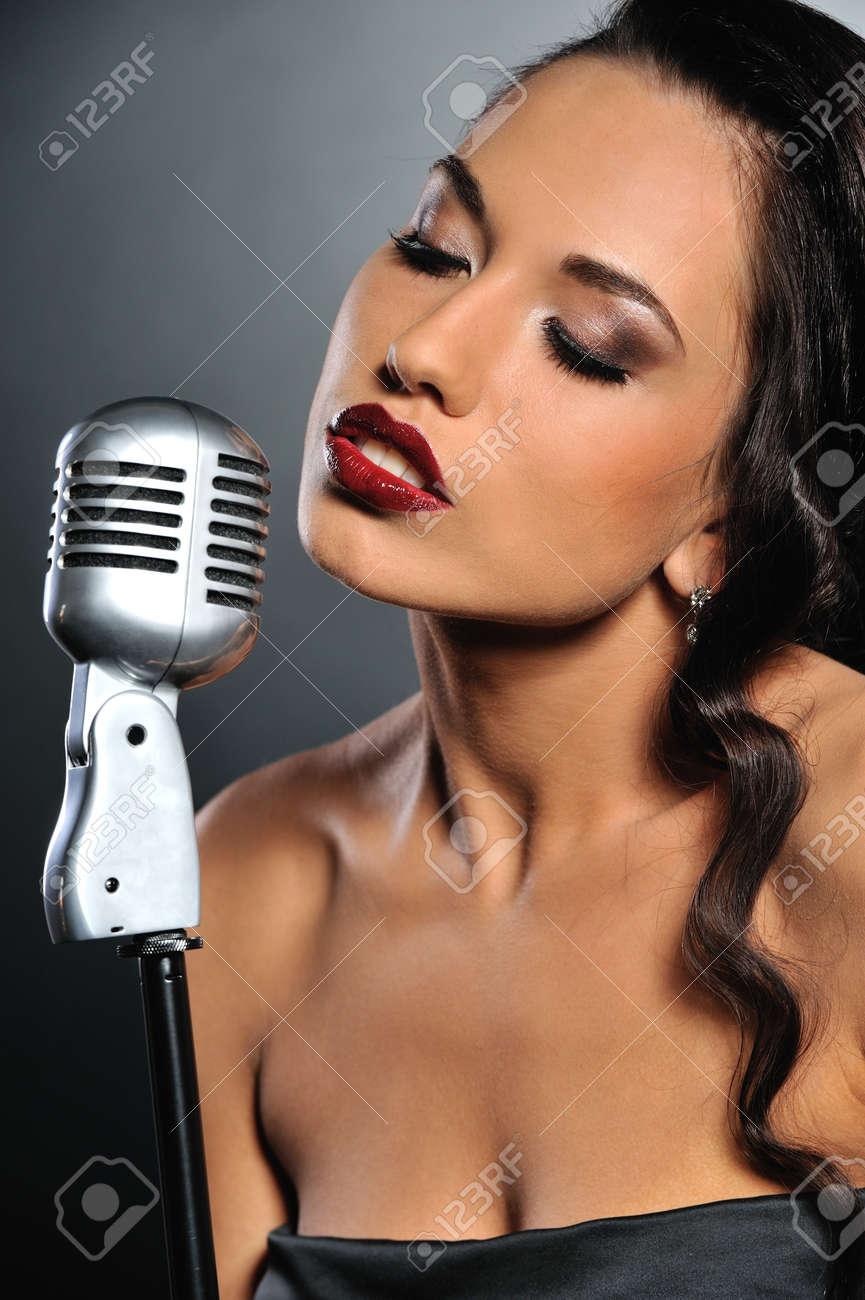 Beautiful brunette woman singing Stock Photo - 6976516