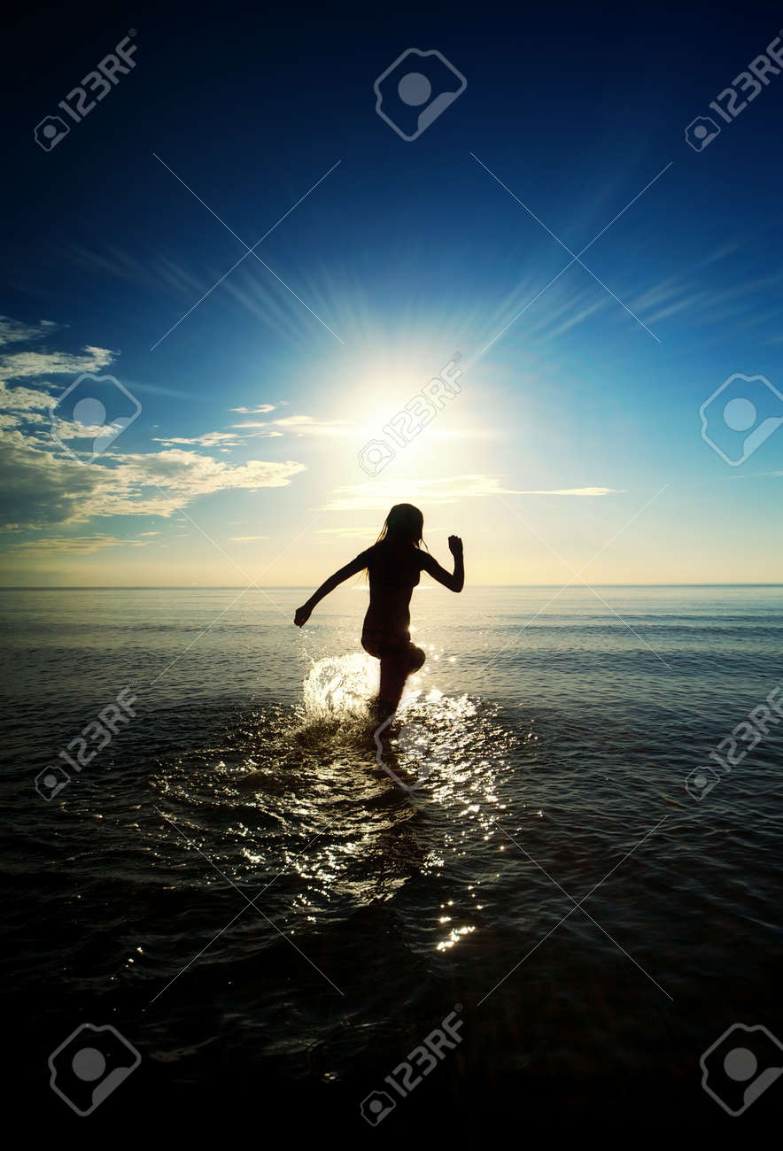 Happy girl running in the sea Stock Photo - 8131716