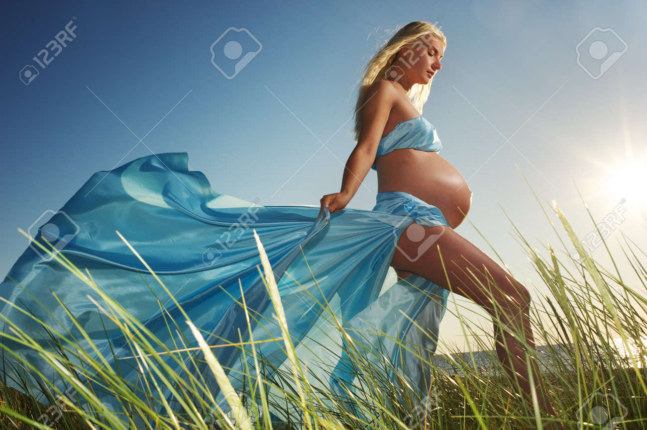 Beautiful pregnant woman outdoors Stock Photo - 8131740