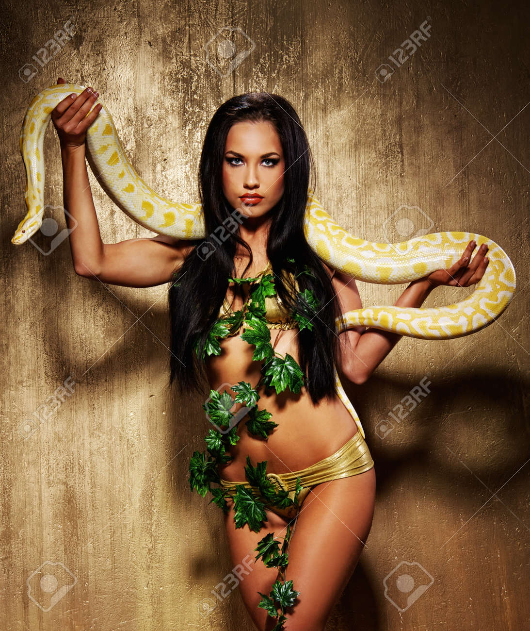 Attractive brunette woman with python Stock Photo - 9008559