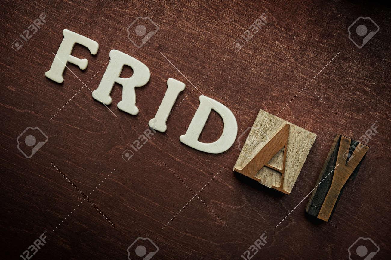 The word friday written on wooden backgroun Stock Photo - 9252647