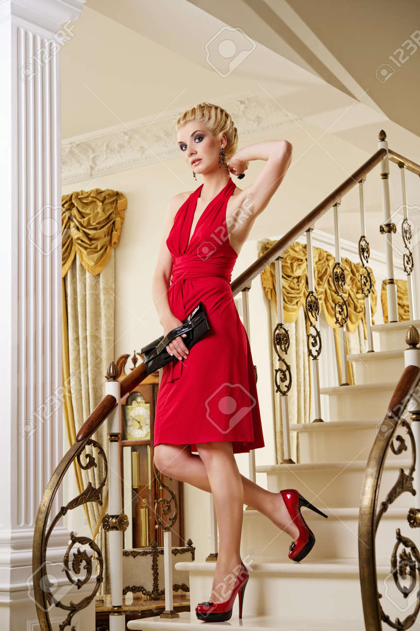 Beautiful blond woman on the stairs Stock Photo - 9904812