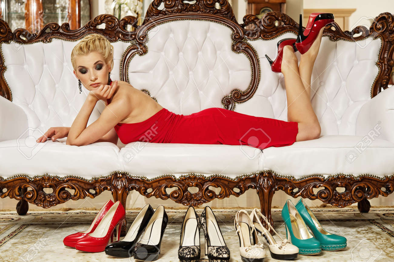 Beautiful glamorous woman looking at shoes Stock Photo - 9657898