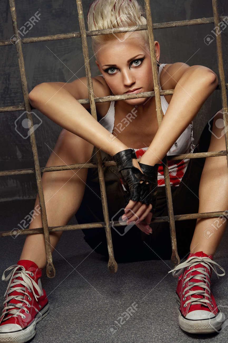 Punk girl behind bars Stock Photo - 9657892