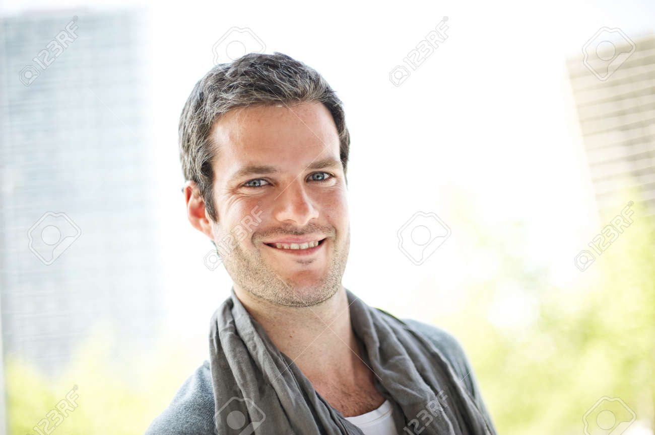 Smiling handsome man outdoors Stock Photo - 9999442