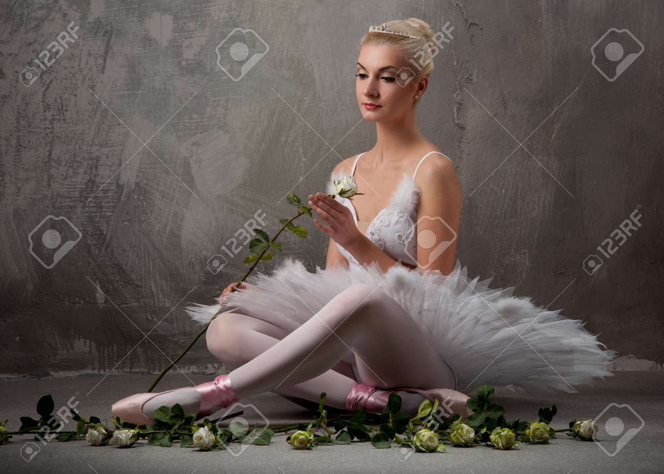 Beautiful ballet dancer with a white roses Stock Photo - 9949817