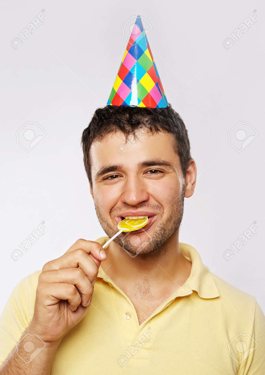 Stock Photo , Funny man with a lollipop.