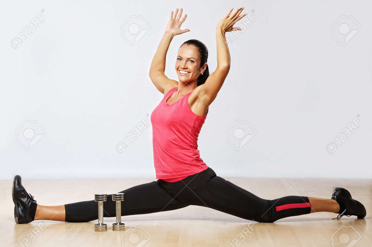 Beautiful woman exercising in fitness club. Stock Photo - 10199622