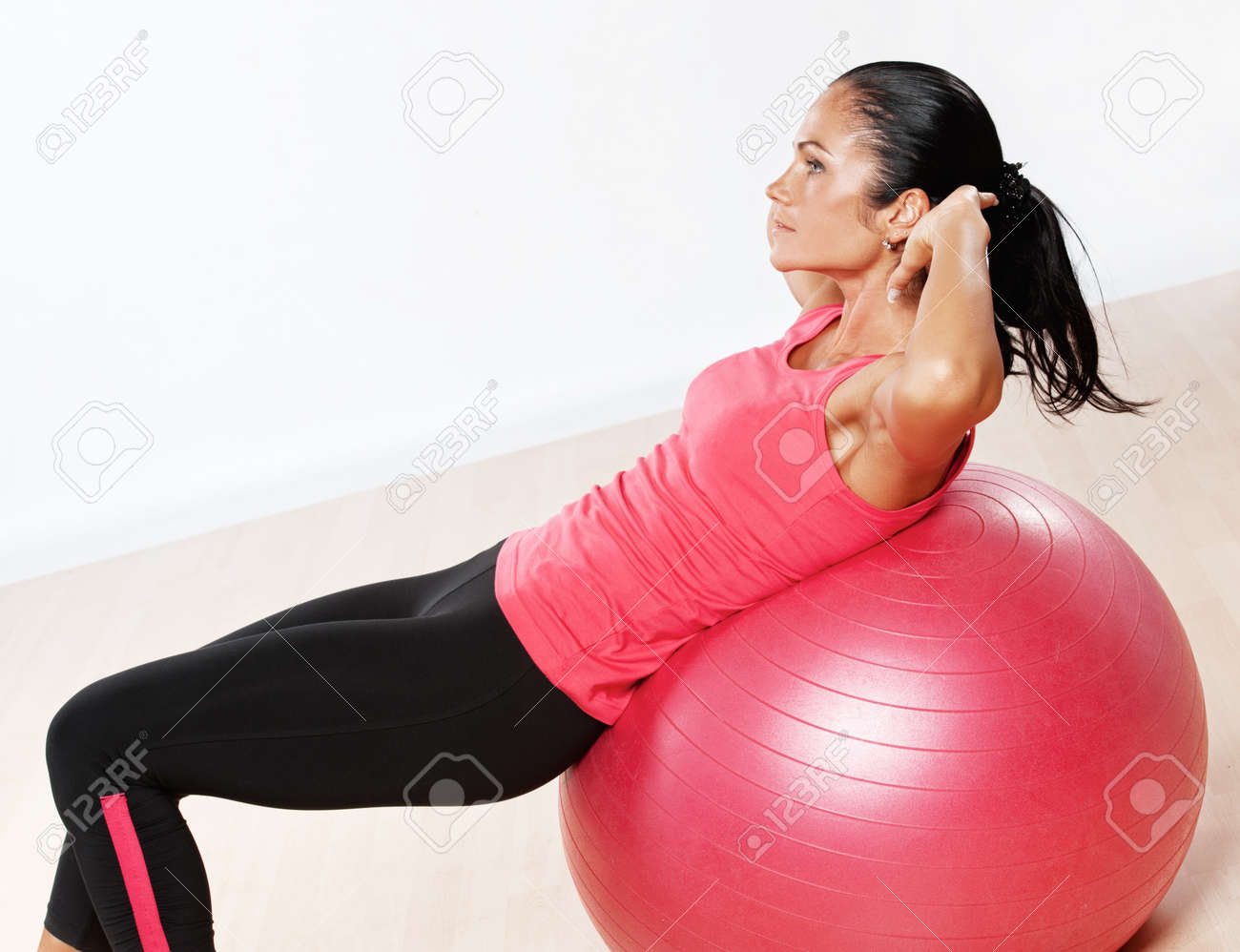 Beautiful athlete woman doing fitness exercise. Stock Photo - 10467413