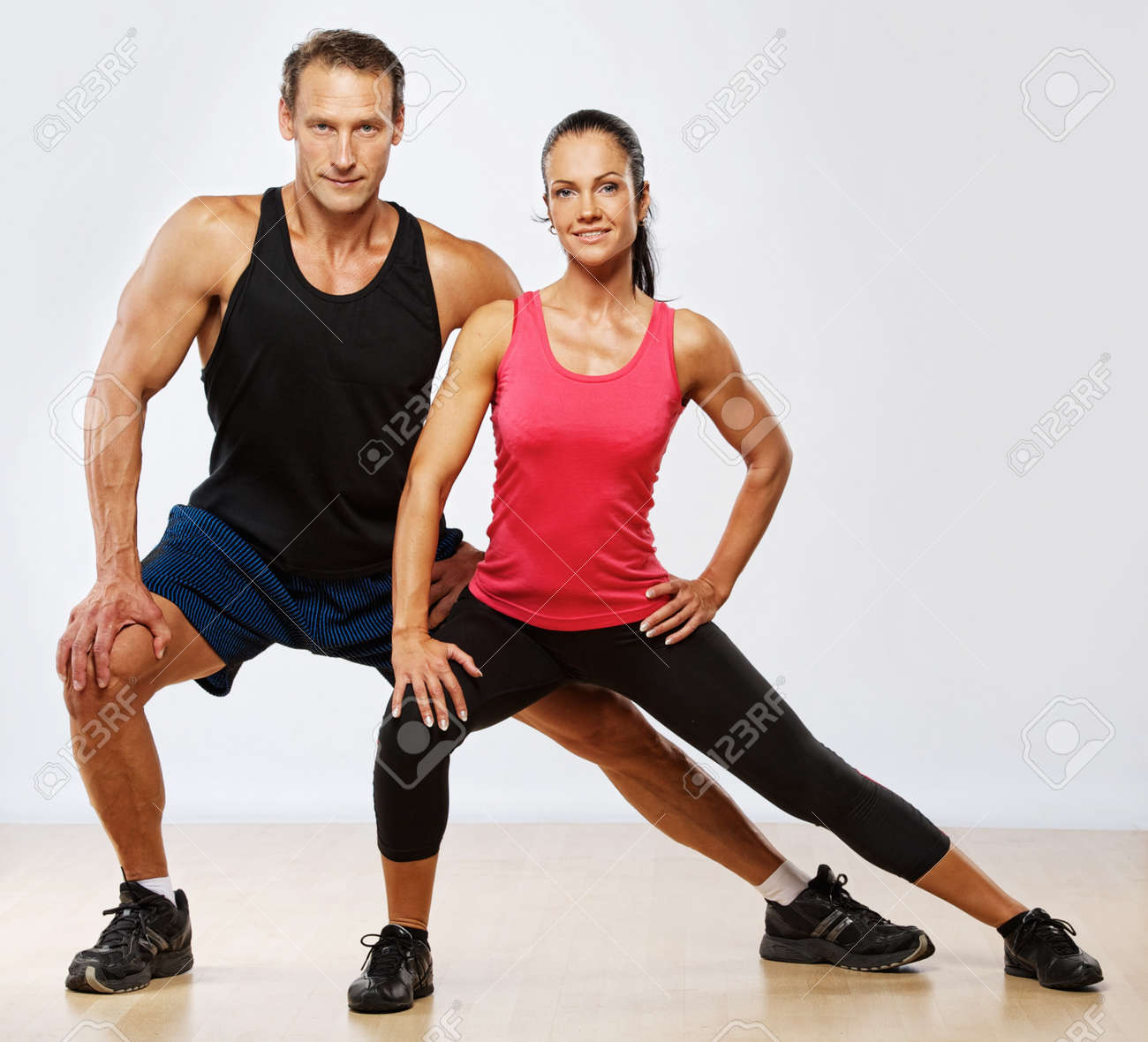 Athletic man and woman doing fitness exercise Stock Photo - 10479370