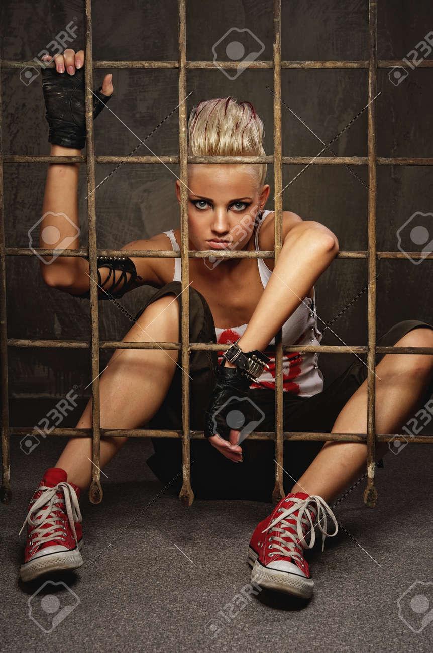 Punk girl behind bars Stock Photo - 10989382