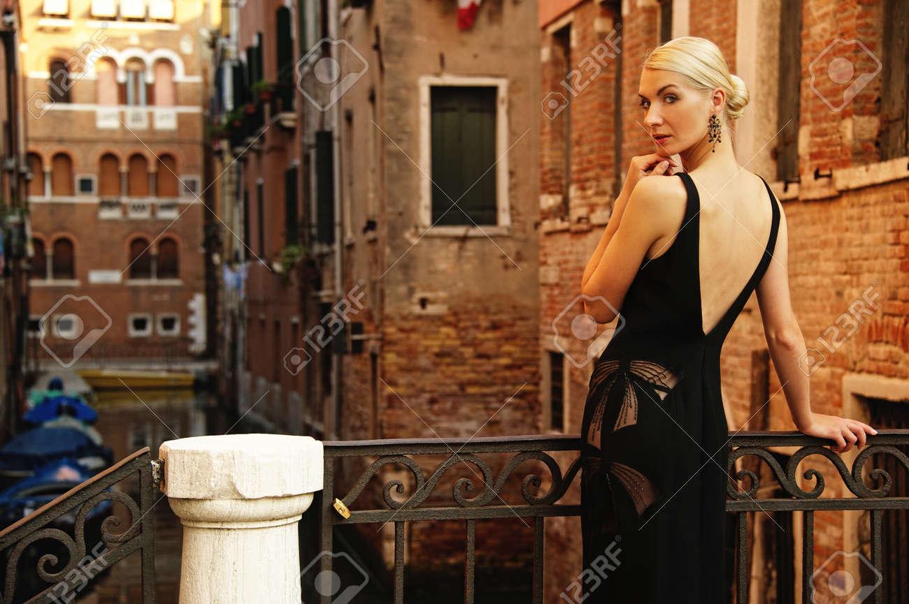 Beautifiul woman in black dress on a bridge Stock Photo - 10994506