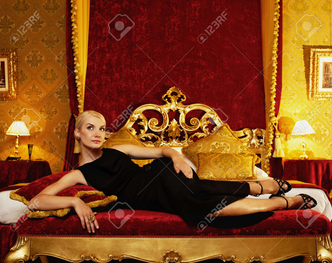 Beautiful woman lying on bed in luxury interior Stock Photo - 12165049