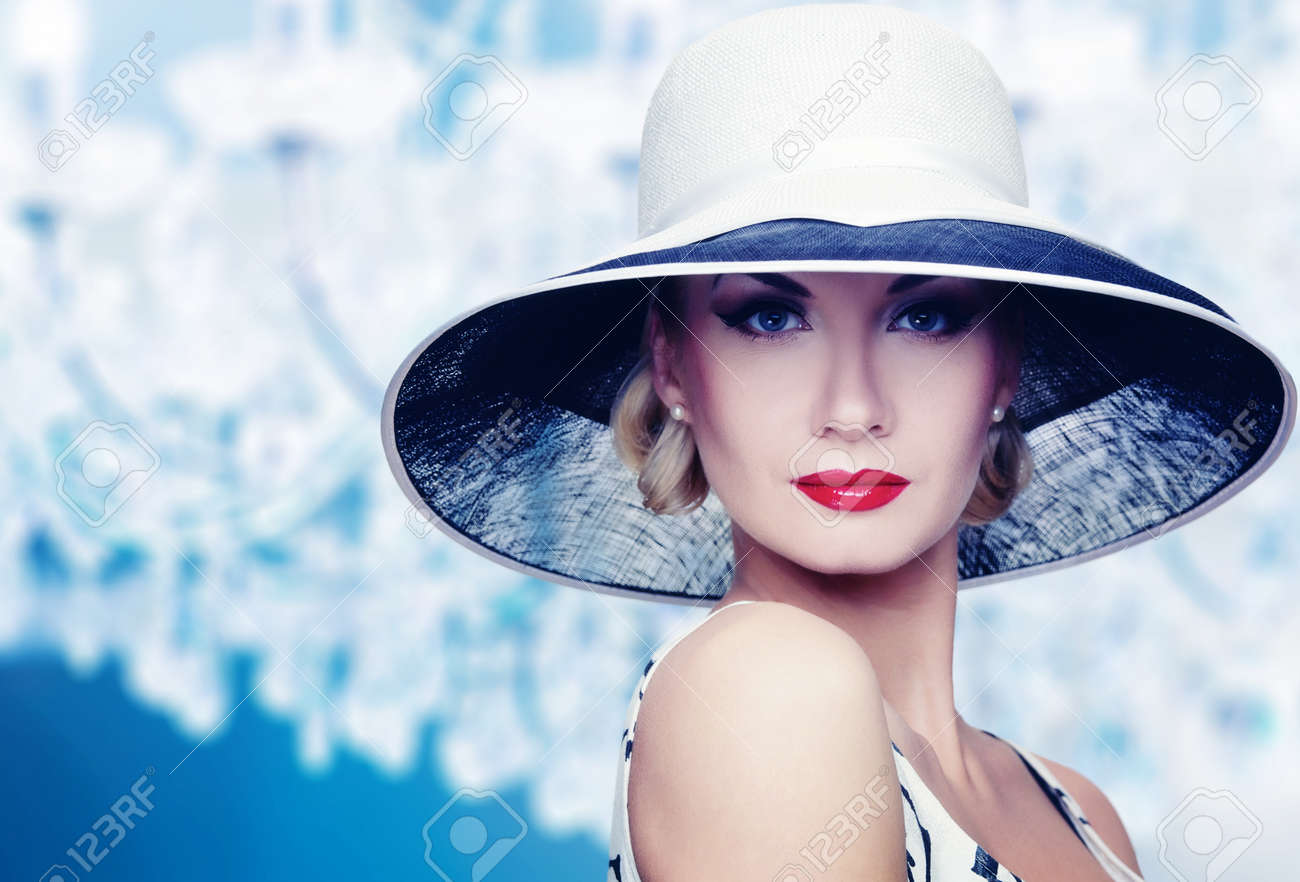 Woman in hat on vintage crystal lamp background. Stock Photo - 12148680