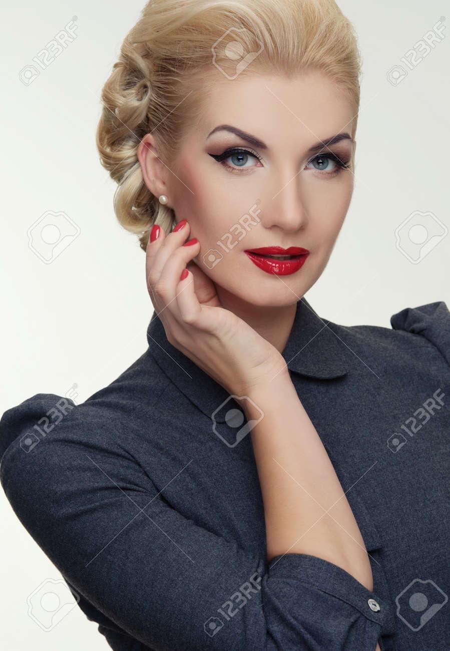 Retro woman in grey dress. Stock Photo - 12148676