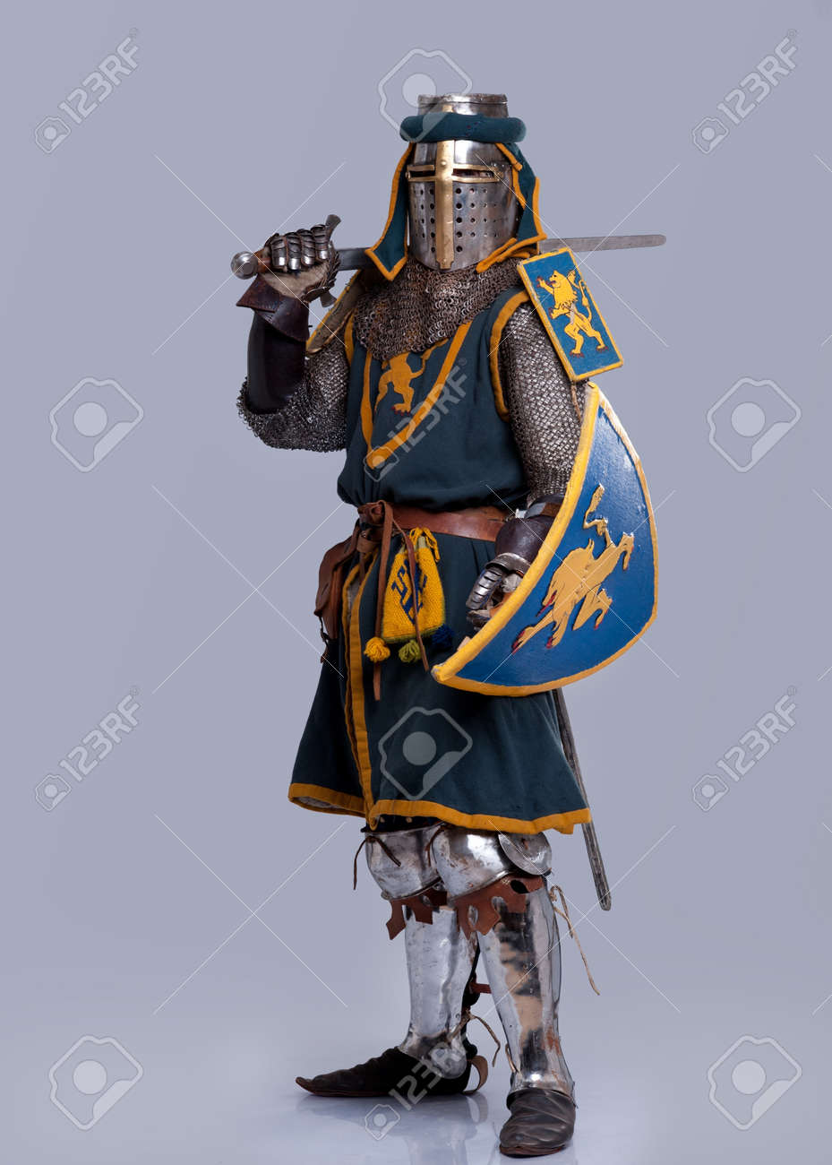 Medieval knight isolated on grey background. Stock Photo - 12079945