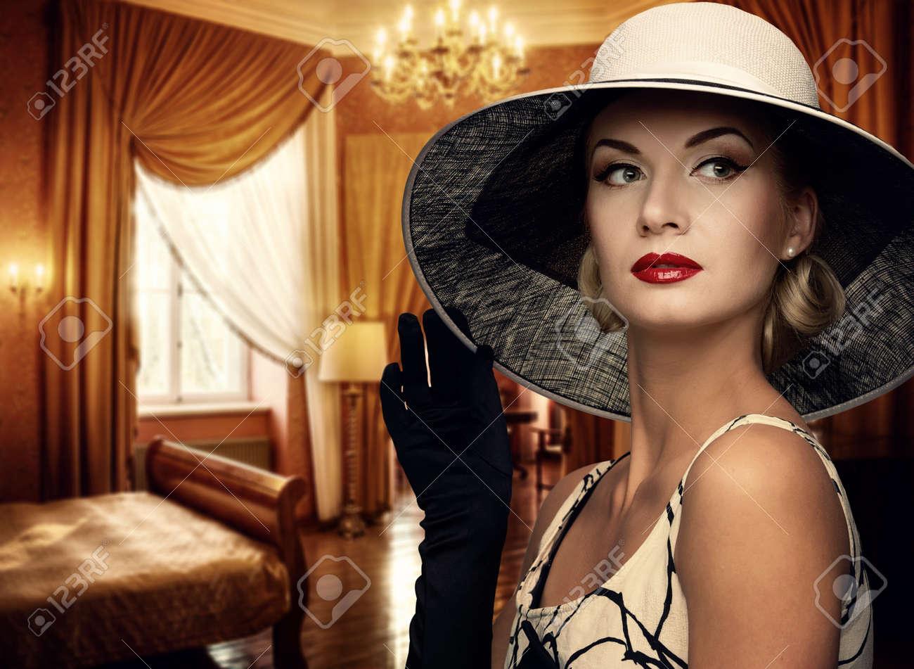 Beautiful woman in hat in luxury room. Stock Photo - 12164948