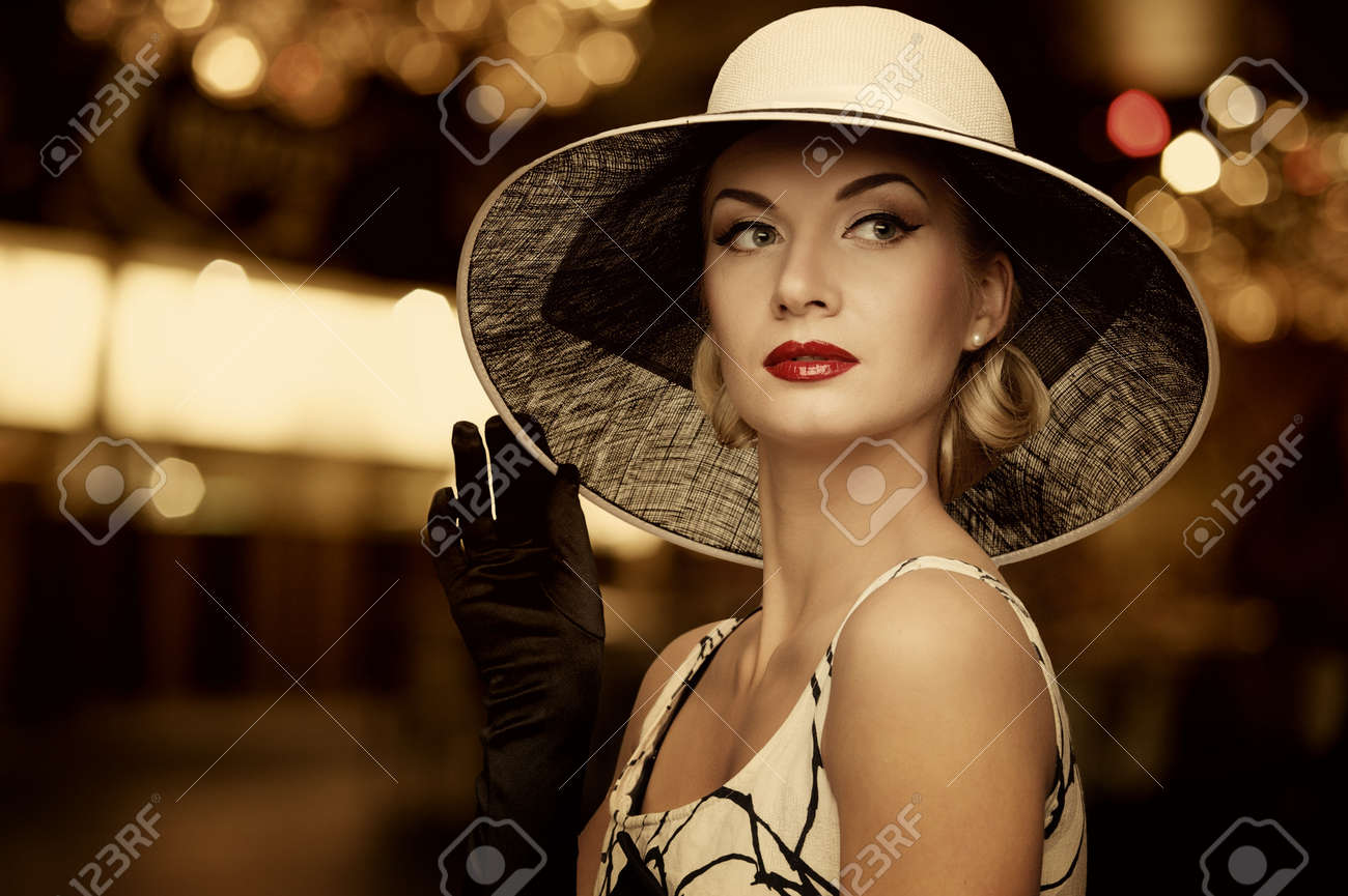 Woman in hat over blurred background. Stock Photo - 12221646