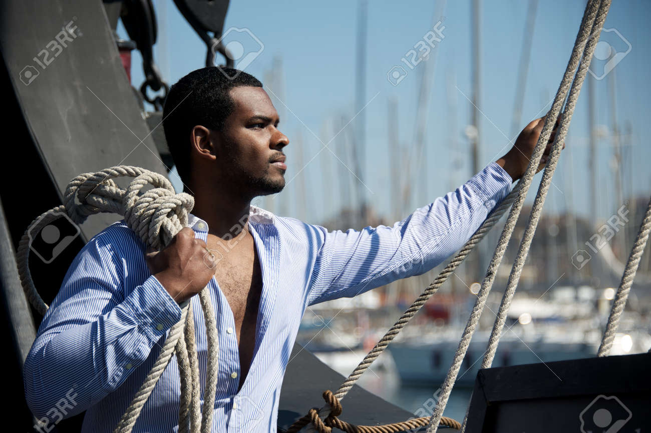 Handsome afro-american sailor against boats Stock Photo - 12609153