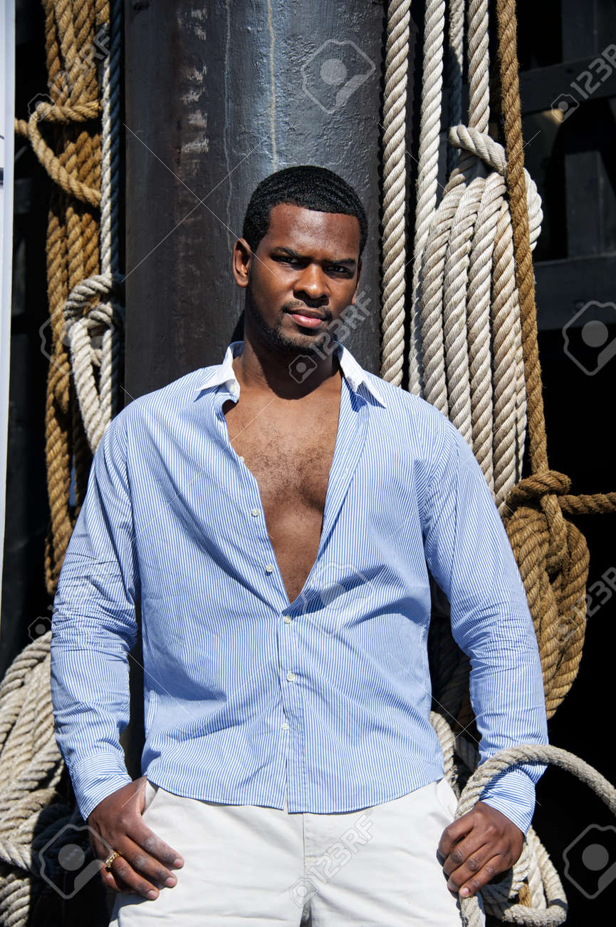 Handsome man against sailing tackles Stock Photo - 12609164