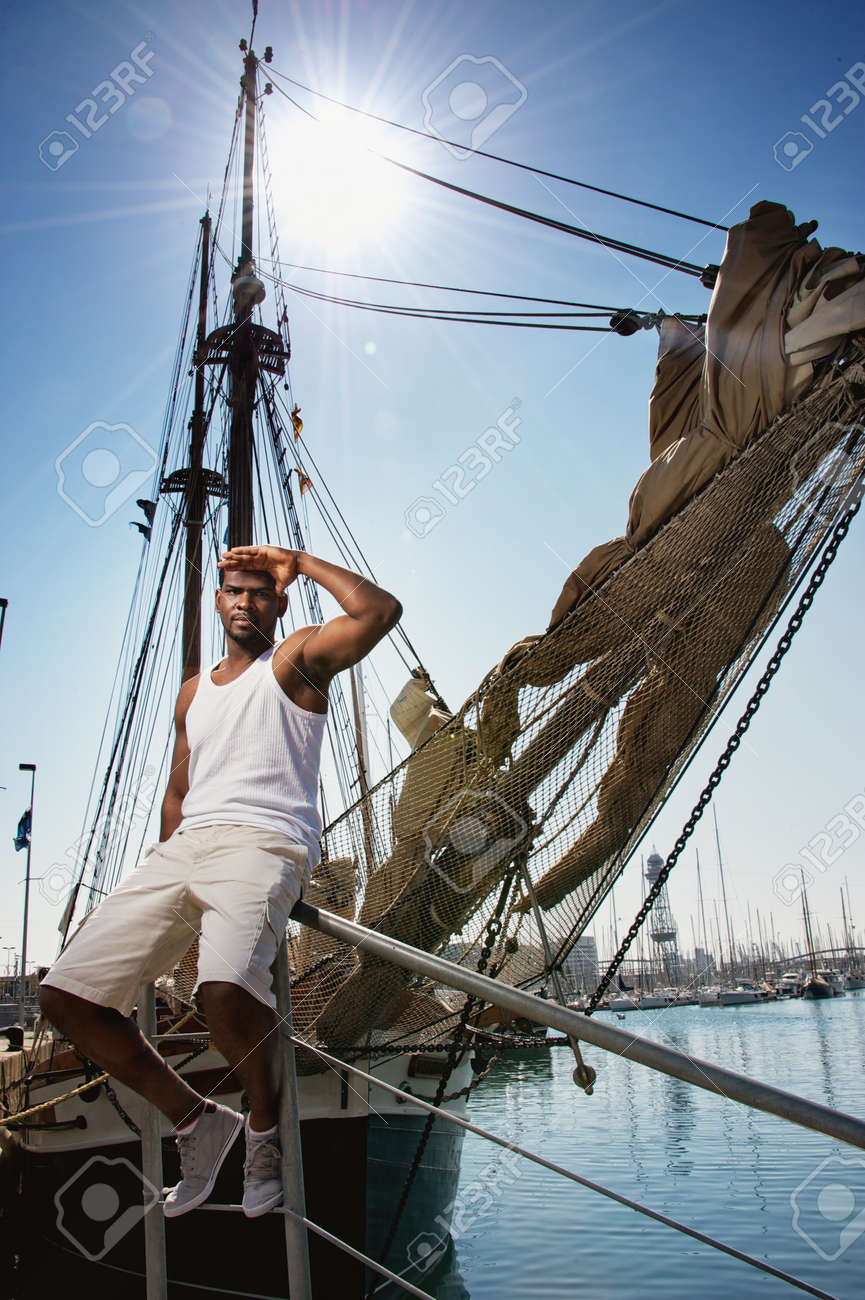 Handsome afro-american man against boat in port Stock Photo - 12609162