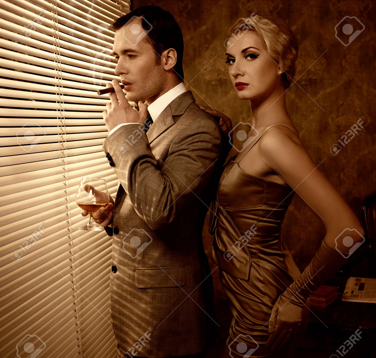 Retro couple near a window Stock Photo - 13809595