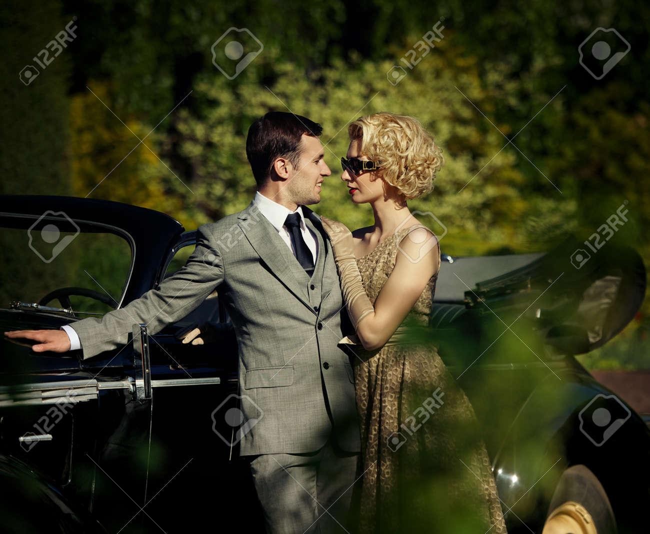 Couple near a retro car outdoors Stock Photo - 13809585