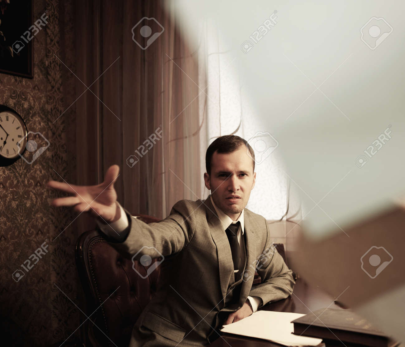 Angry businessman throwing a documents Stock Photo - 14075240