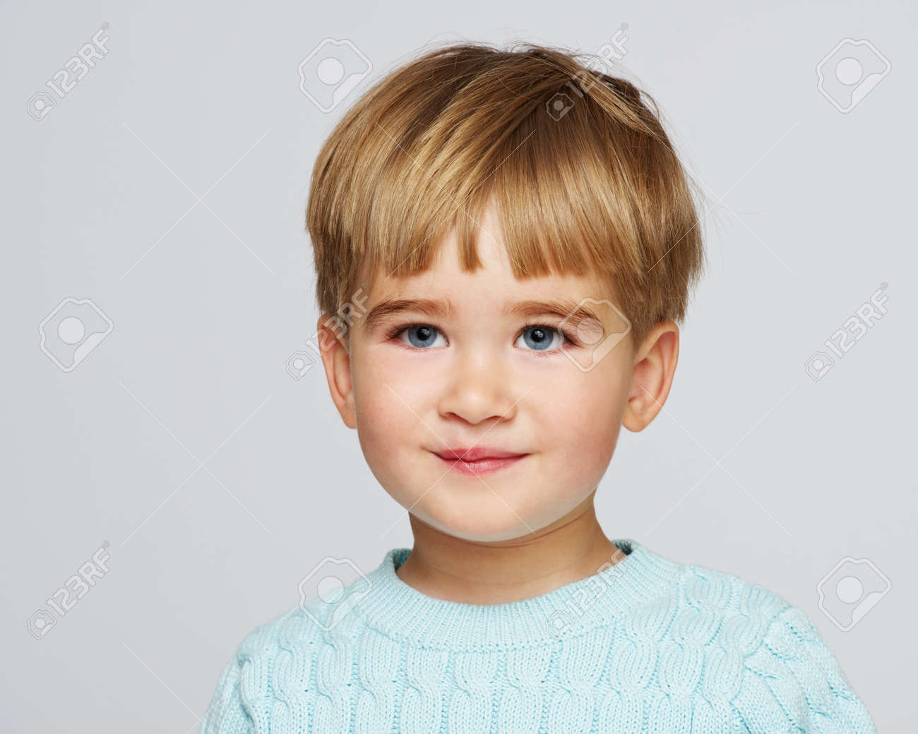 Smiling baby boy in blue pullover portrait Stock Photo - 14082204