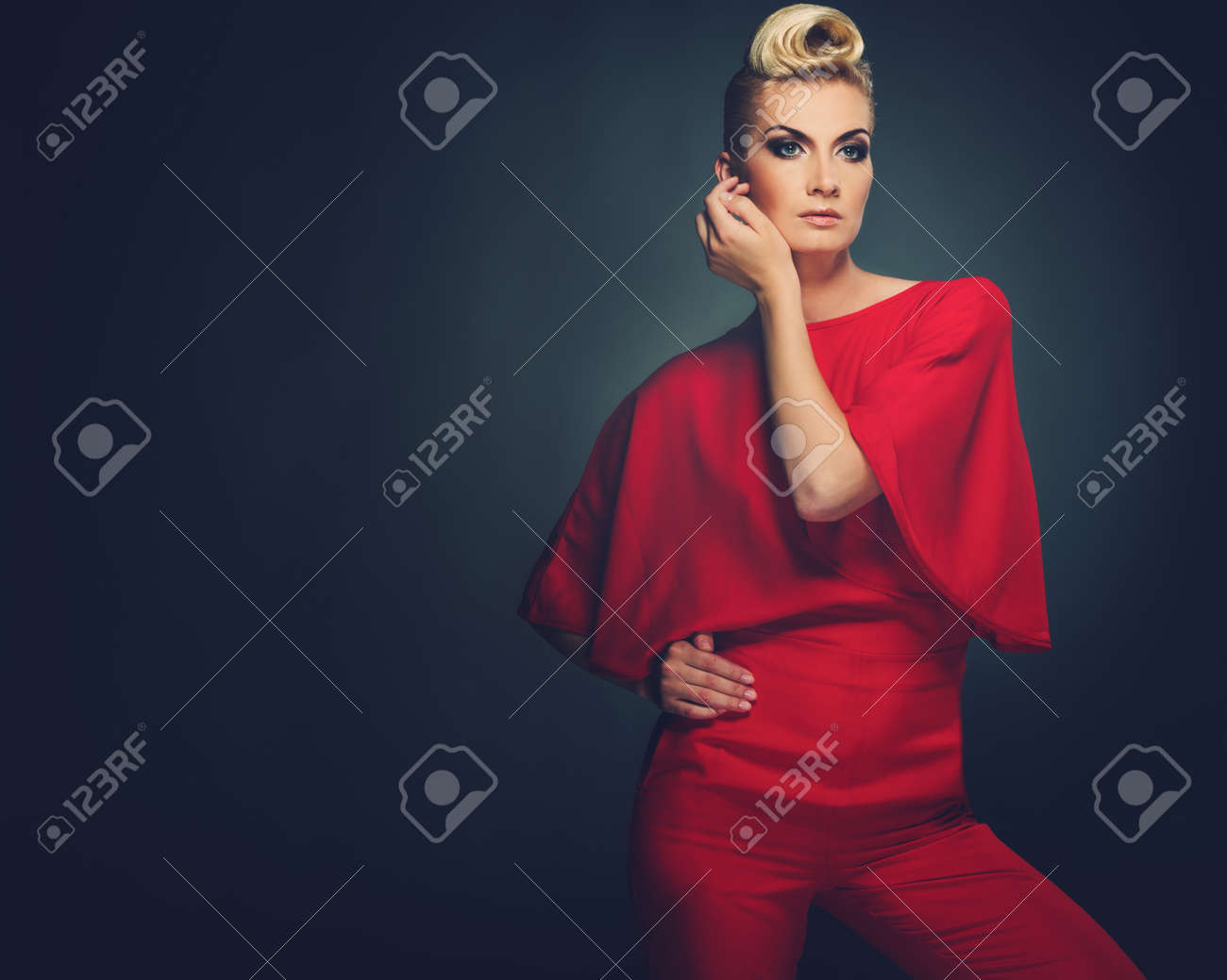 Fashionable woman in red with creative hairstyle Stock Photo - 15647789