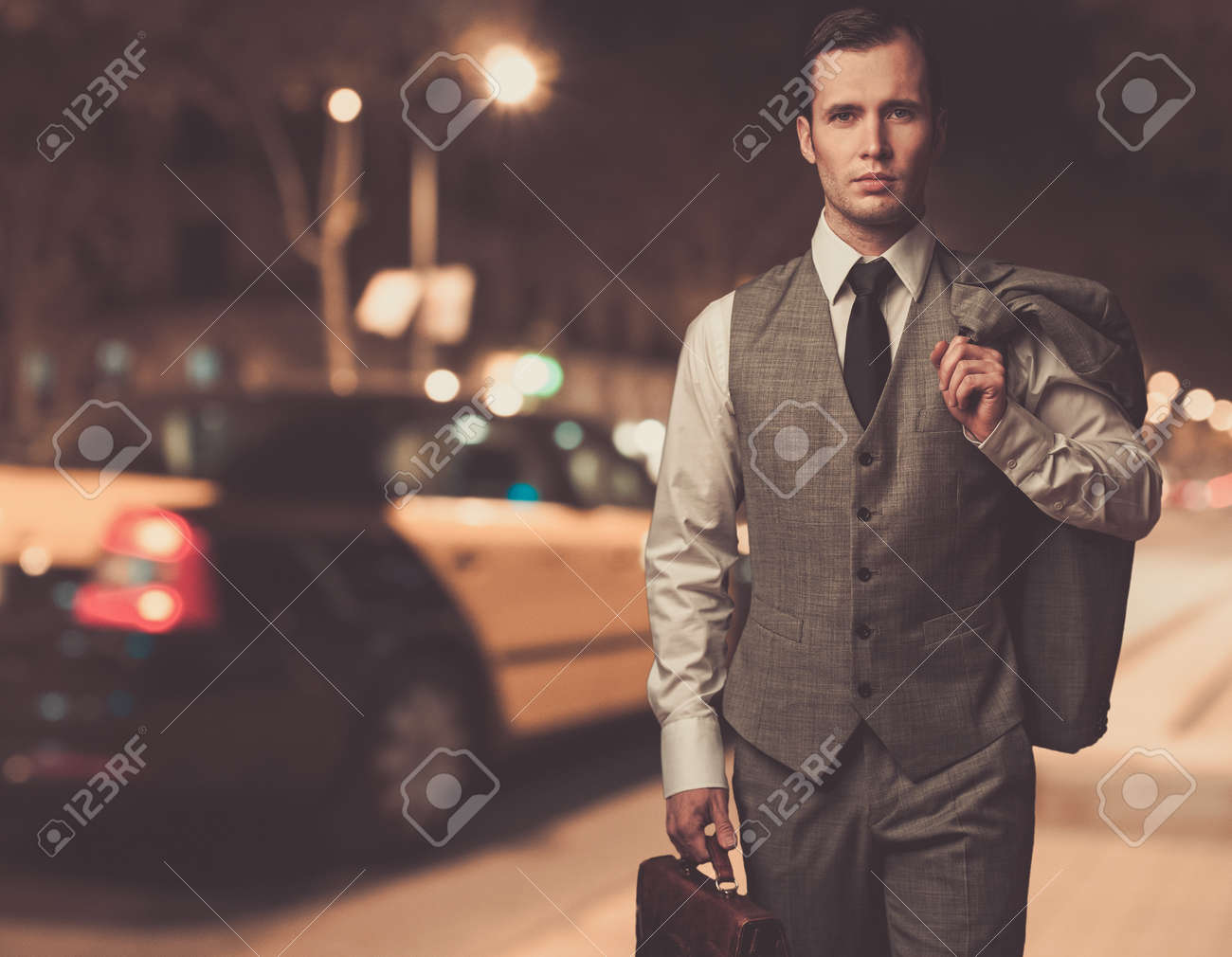 Man In Classic Grey Suit With Briefcase Walking Outdoors At Night ...