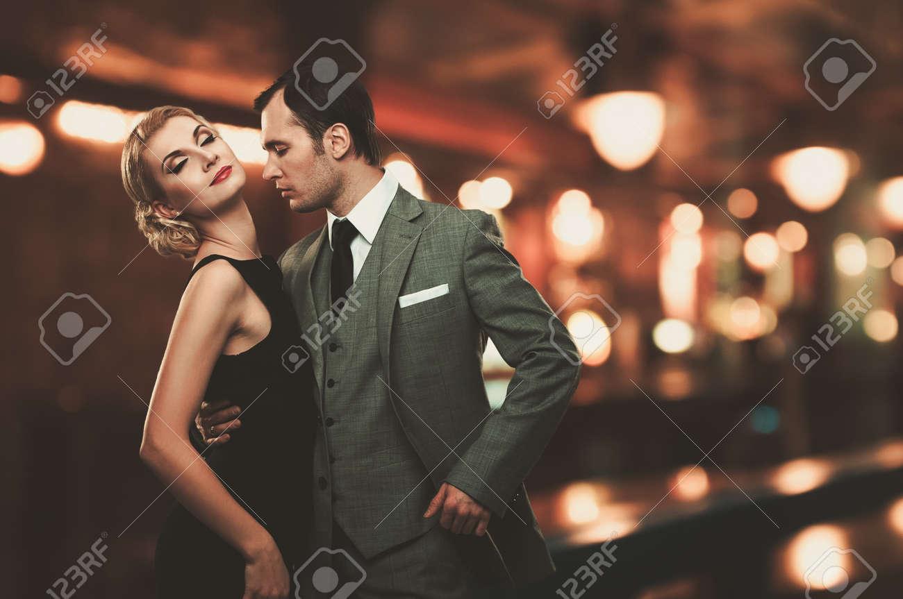 Retro couple over blurred background Stock Photo - 16305207