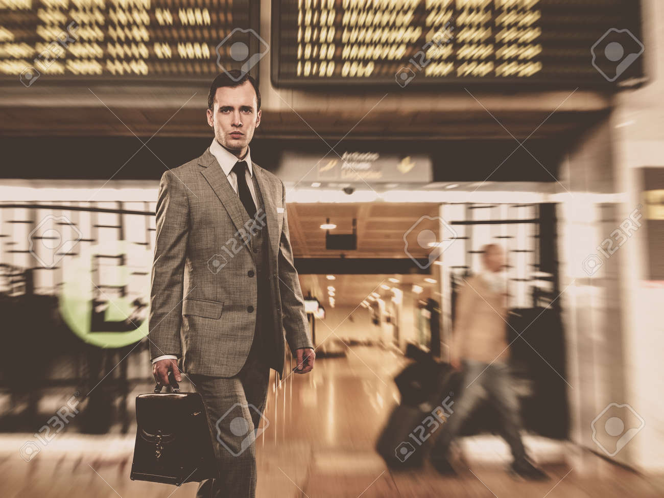 Man in classic grey suit with briefcase in airport Stock Photo - 16548609