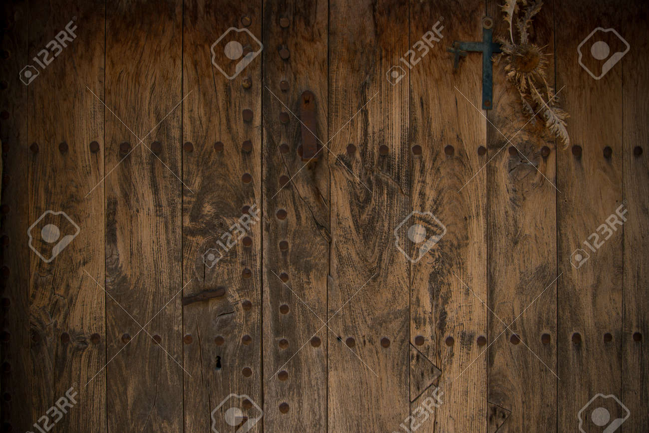 Old wooden door with metal knobs background Stock Photo - 16508935